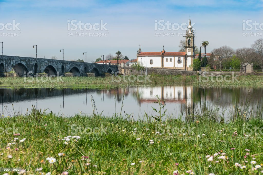 Santo Antonio da Torre Velha church with roman bridge in Ponte de Lima town, Portuga stock photo