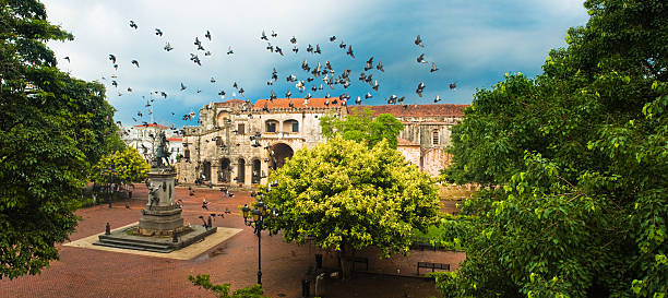 Santo Domingo Main Square Doves flying over main square with Columbus statue, Santo Domingo, Dominican Republic colonial style stock pictures, royalty-free photos & images