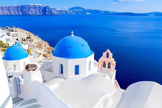 santorini blue dome churches - santorini stock photos and pictures