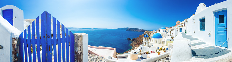 Panorama of Santorini caldera with famous Orthodox churches with blue domes in village Oia (Ia). Click for more images: http://santoriniphoto.com/Template-Greek.jpg