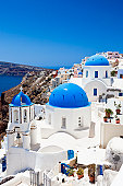 Famous Orthodox church with blue domes in village Oia (Ia) on Santorini island. Click for more images: