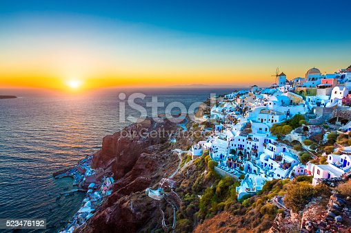 Traditional Greek village Oia (Ia) on Santorini island in dusk, Cyclades, Greece.