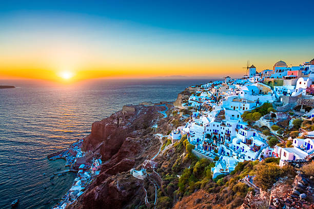 Santorini Oia village, Greece Traditional Greek village Oia (Ia) on Santorini island in dusk, Cyclades, Greece.  mediterranean sea stock pictures, royalty-free photos & images