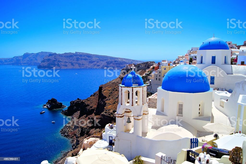 Santorini scene with famous blue dome churches, Greece stock photo