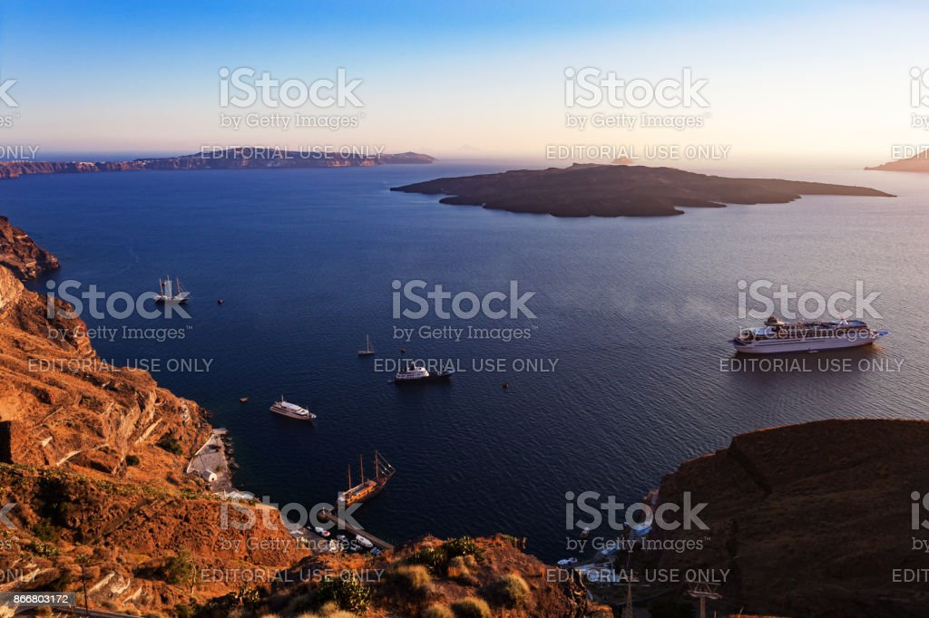 Santorini sea with Nea Kameni volcanic and cruise ships stock photo