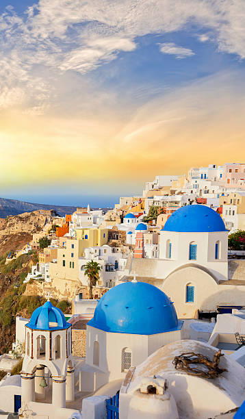 santorini sunset over the village of oia in greece - santorini stock photos and pictures