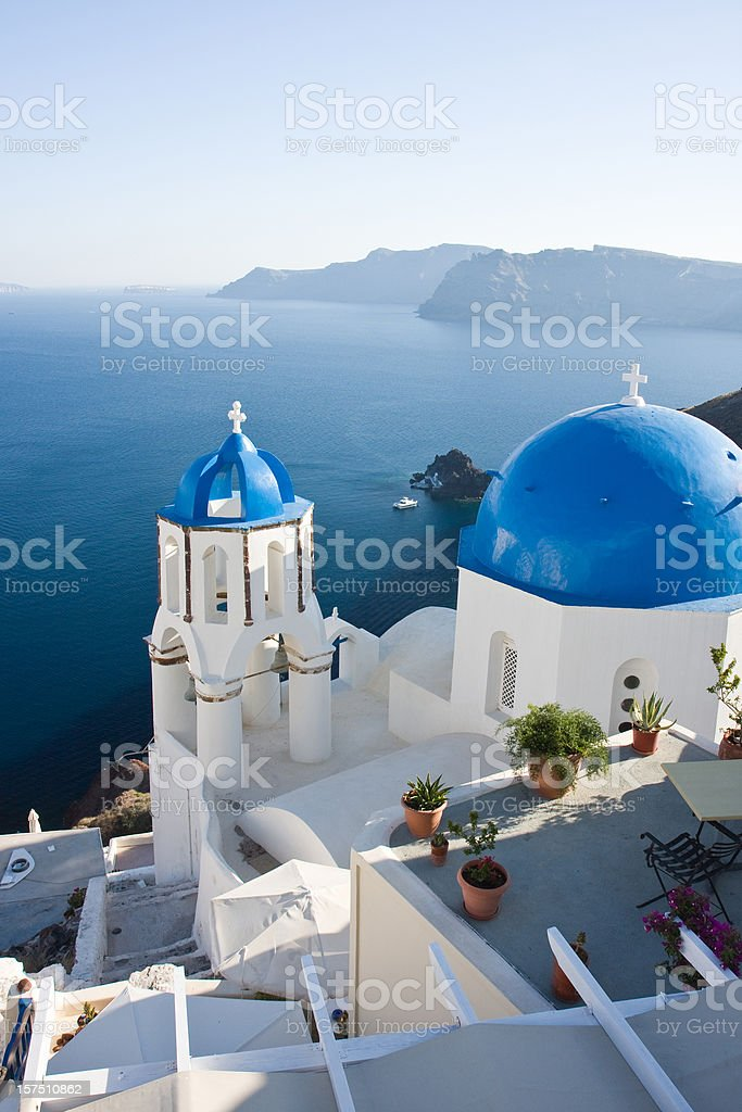 Santorini terrace and churches with blue roofs royalty-free stock photo