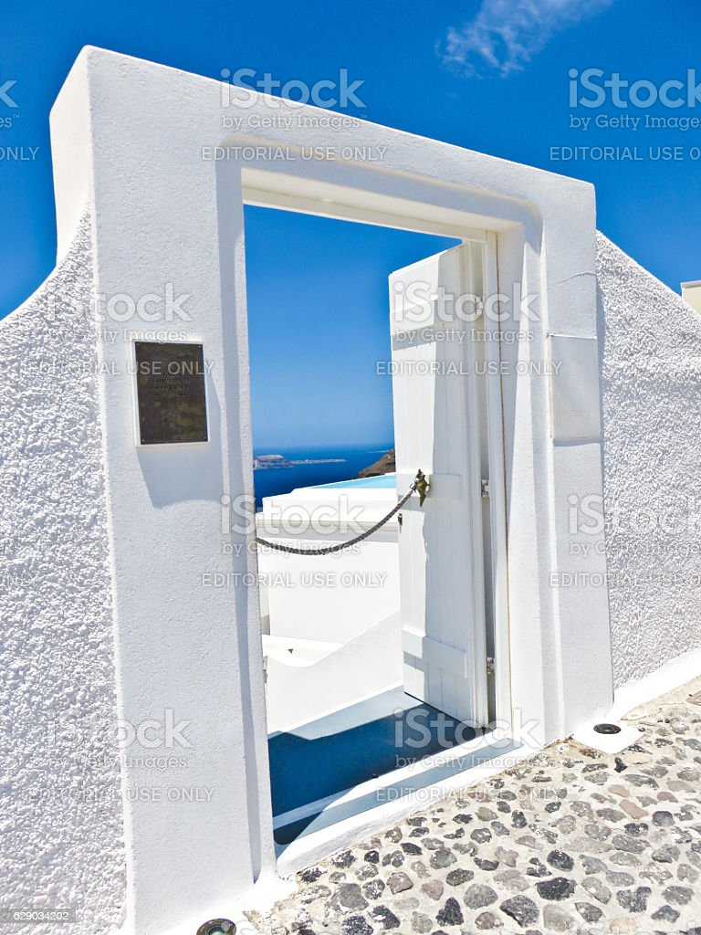 Santorini White Door Frame with Ocean View and Blue Skies. stock photo
