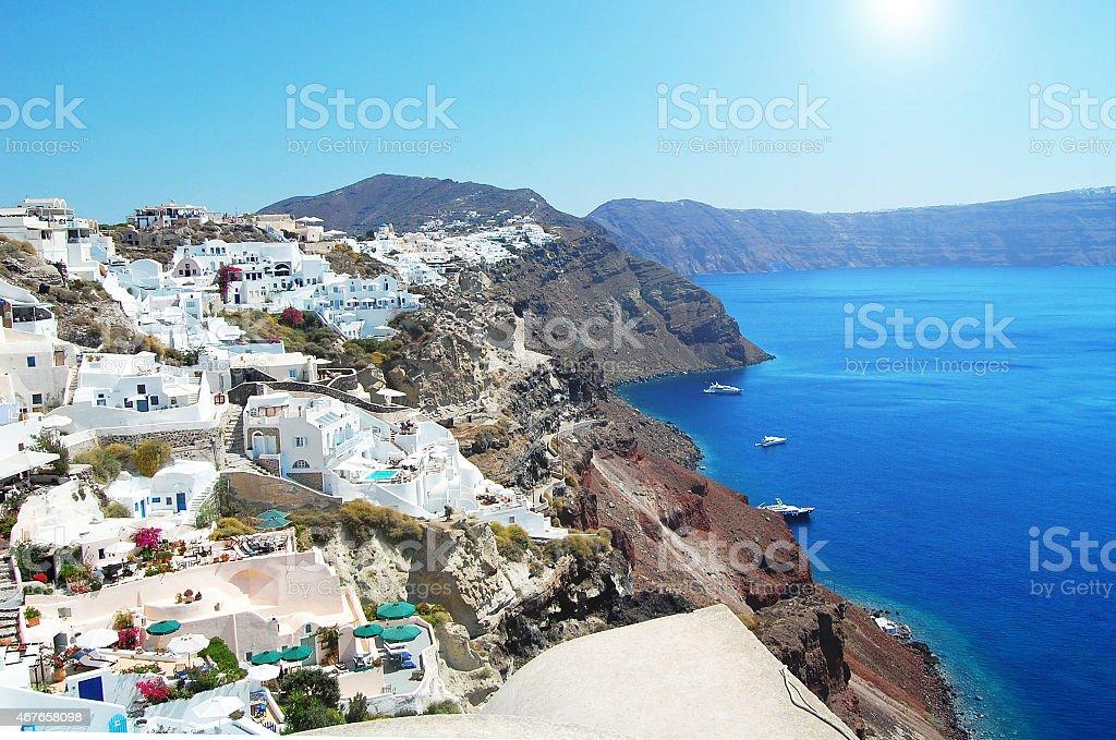 Santorini white village on the cliff with view to the sea stock photo