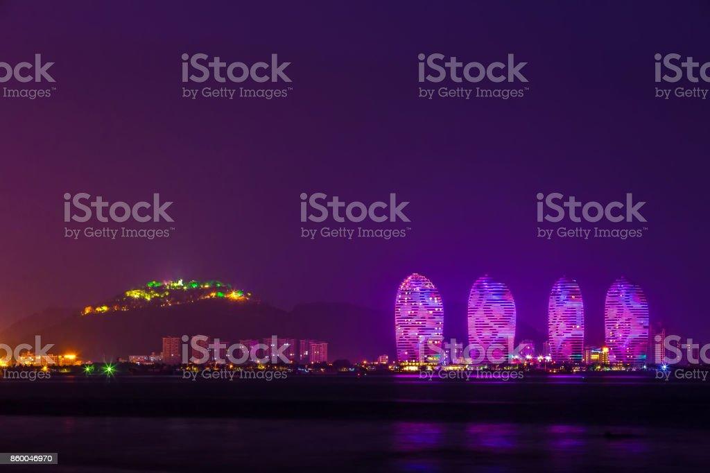 Sanya Phoenix Island President Resort Apartment at night, Hainan Sheng, Sanya Shi, Tianya Qu, China. stock photo