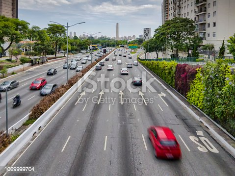 Photo taken above  of an important avenue of Sao Paulo city. The name of this avenue is 23 de maio. Obelisk s on background.