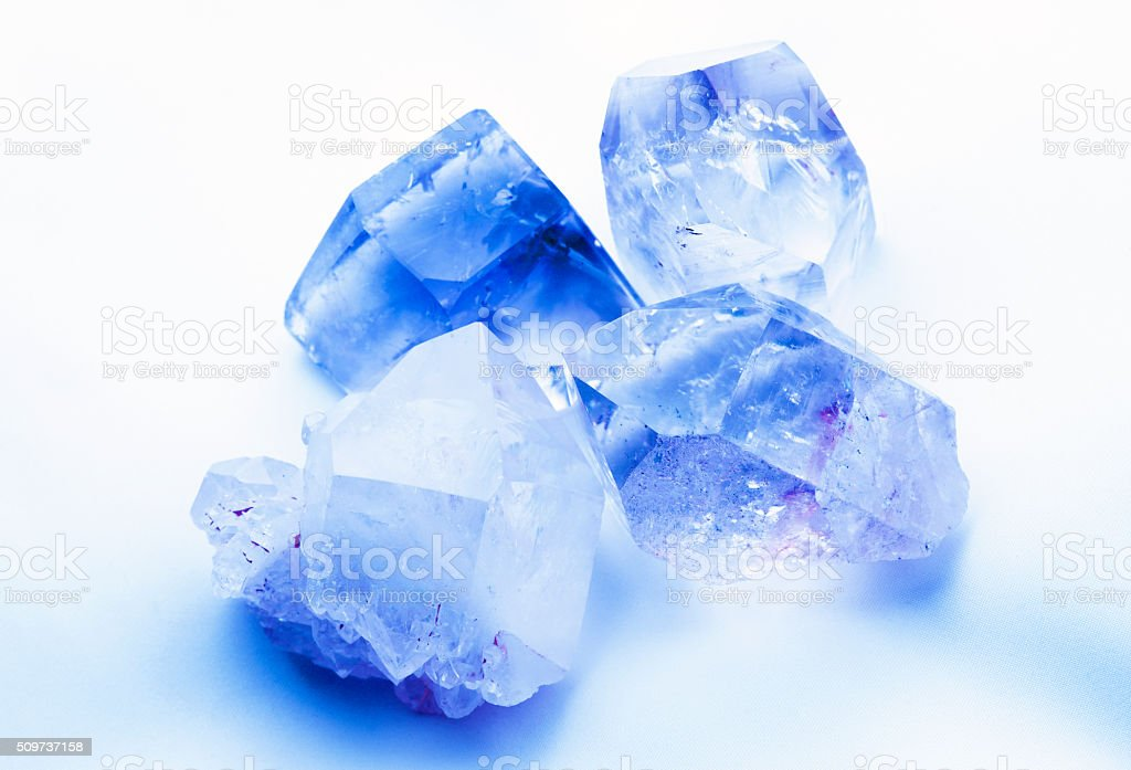 Sapphire blue colored rock crystals stock photo