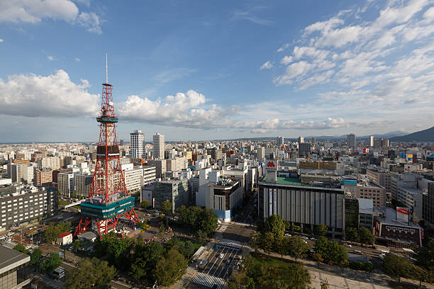 sapporo cityscape with sapporo tv tower in japan - sapporo stock photos and pictures