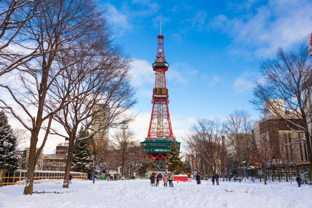 sapporo, japan - 30 december 2017 - sapporo tv tower, famous landmark for visitors around the world, stands tall against blue sky on a cold winter day of december 30, 2017 in sapporo, japan - sapporo stock photos and pictures