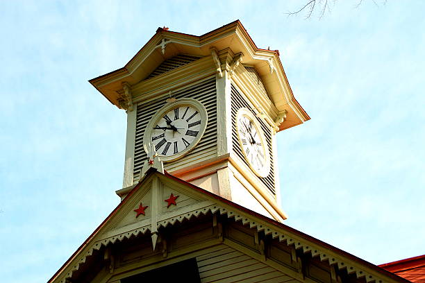 sapporo, japan at the historic clock tower. - sapporo stock photos and pictures