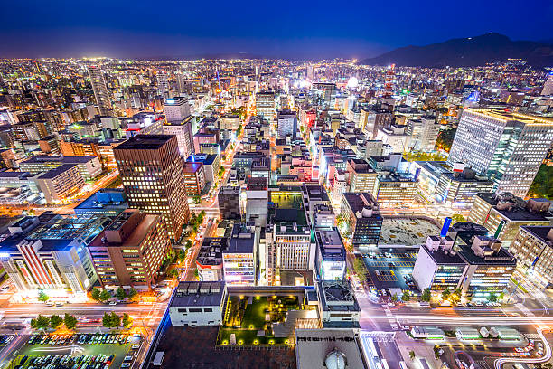 sapporo, japan cityscape - sapporo stock photos and pictures