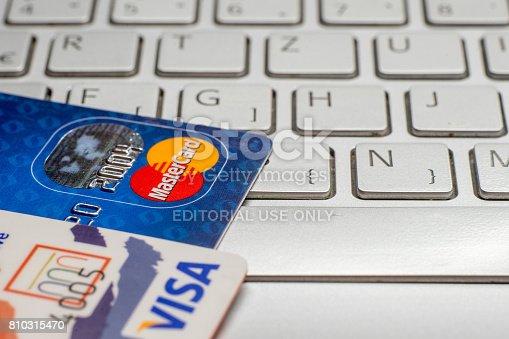 Sarajevo - Bosnia and Herzegovina- 25 January 2017: closeup pile of credit cards, Visa payWawe and MasterCard, credit, debit. On laptop keyboard.