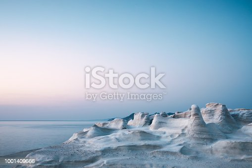 Idyllic white rock formations in Sarakiniko beach in Milos (Cyclades, Greece).