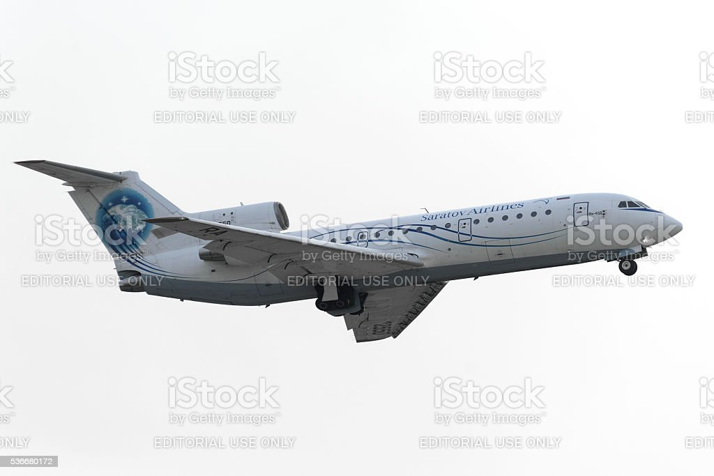 Saratov Airlines Yak-42D takes off stock photo