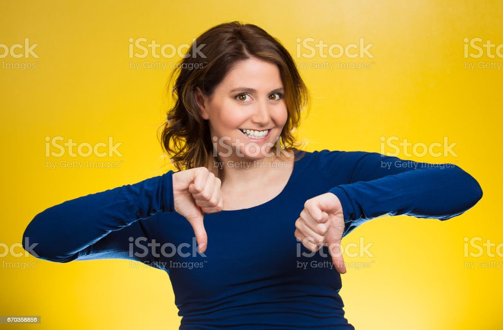 sarcastic young woman showing thumbs down sign hand gesture, happy someone made mistake stock photo