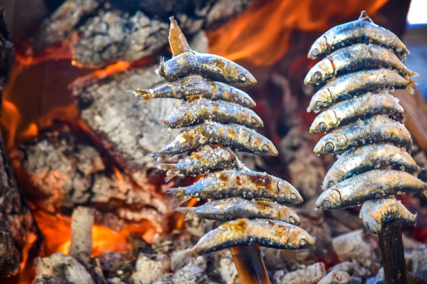 Sardine fish grilled over a wood fire in Malaga in Spain stock photo