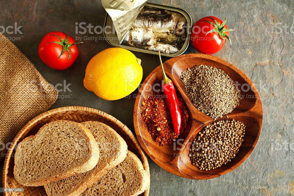 sardines and fresh spices and lemon for dinner stock photo