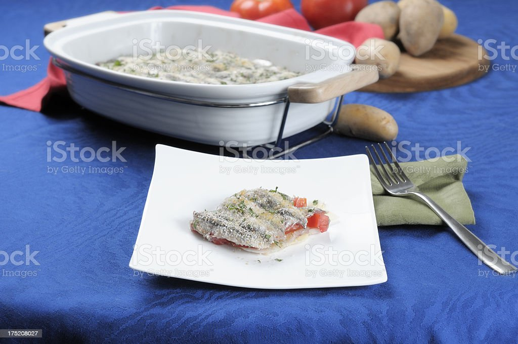 Sardines baked with vegetables royalty-free stock photo