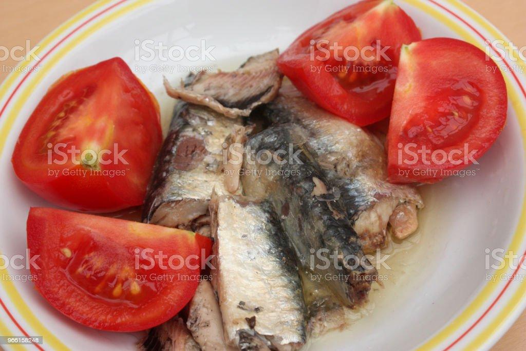 Sardiner i olja (konserverad) tomater från trädgården - Royaltyfri Aperitif - Måltid Bildbanksbilder