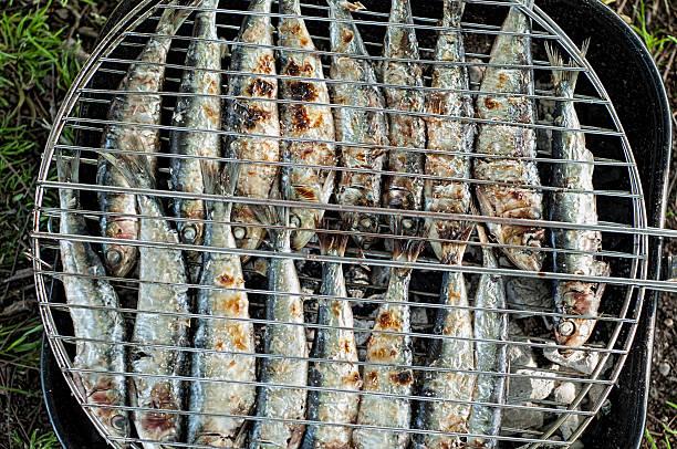 sardines on barbacue stock photo