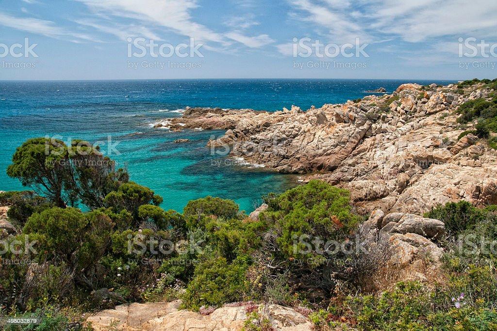 CALA CIPOLLA sardinia crystal water beach stock photo