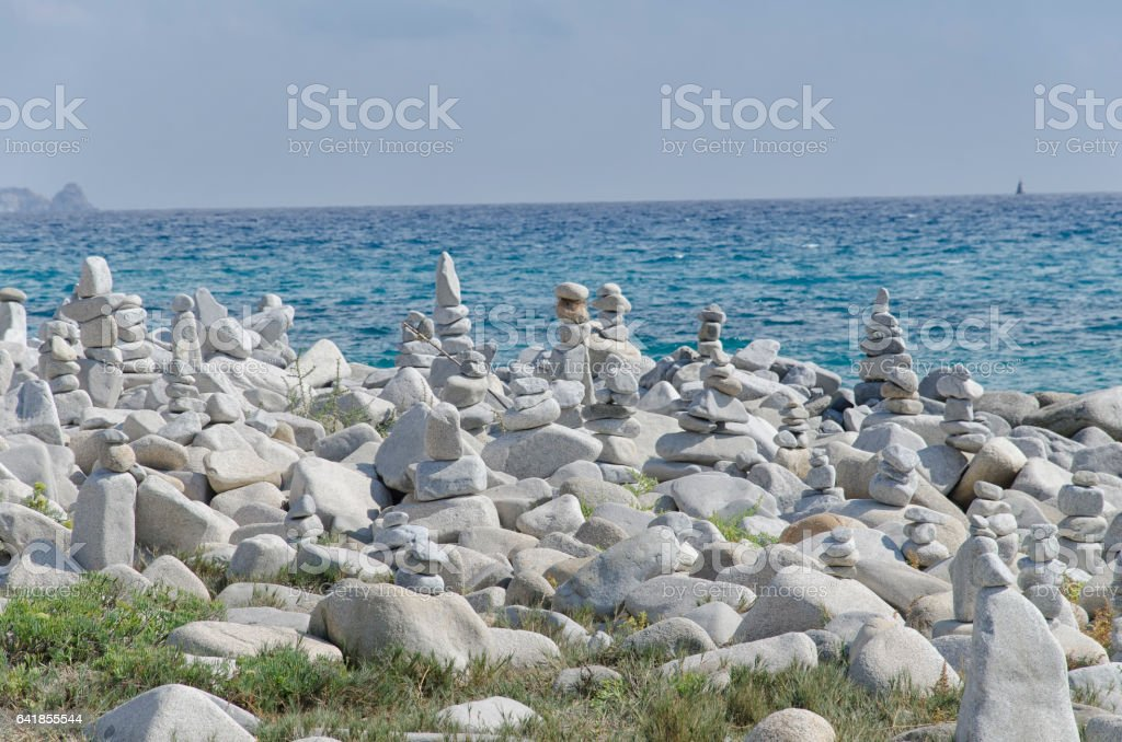 Sardinian beach with stones artwork stock photo