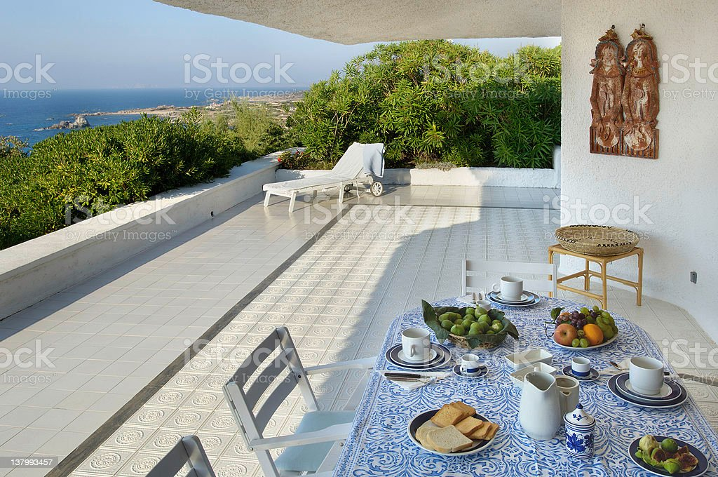 Sardinian house exterior, set table for breakfast in wide terrace stock photo