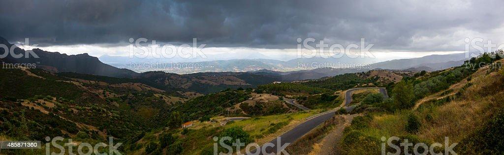 Panorama of a thunderstorm over beautiful sardinian landscape near...