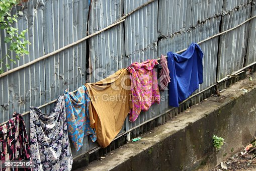 Sarong and Longeje wash and sun on the clothes line at the zinc wall, it is life style of Myanmese.