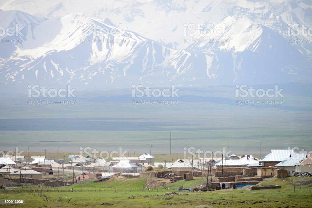 Sary Tash village and beautiful Pamir mountains, M41 Pamir Highway, Kyrgyzstan stock photo