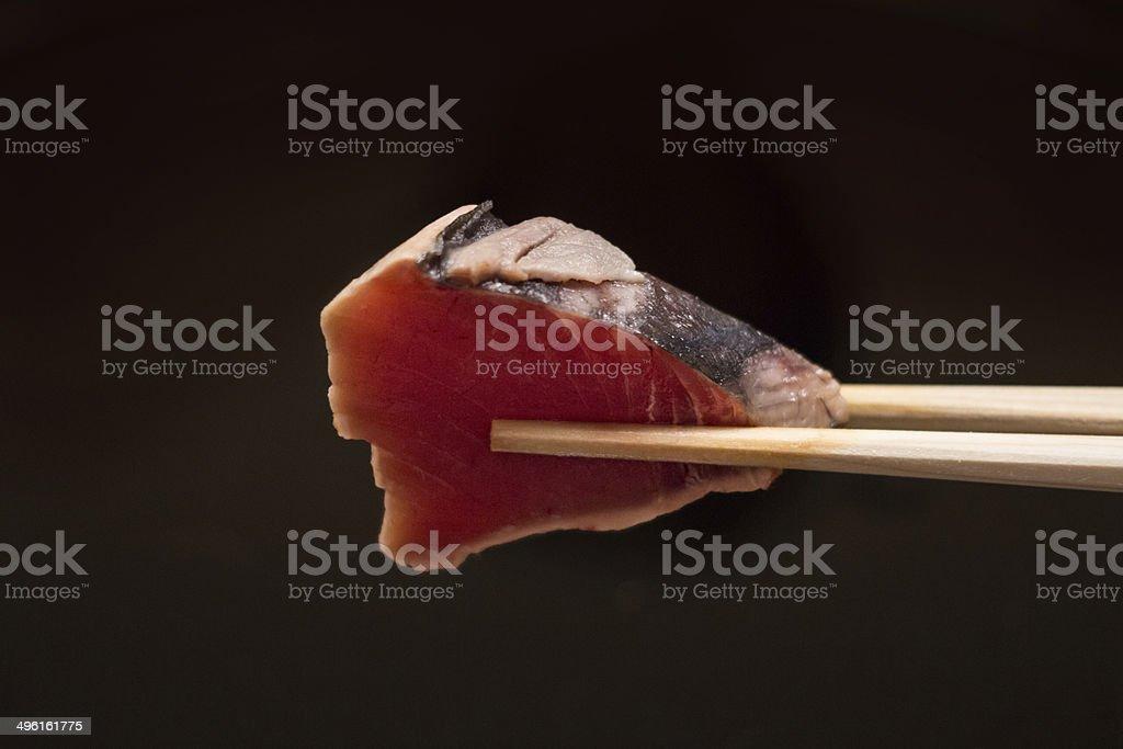Sashimi with chopsticks. Japanese traditional food. stock photo