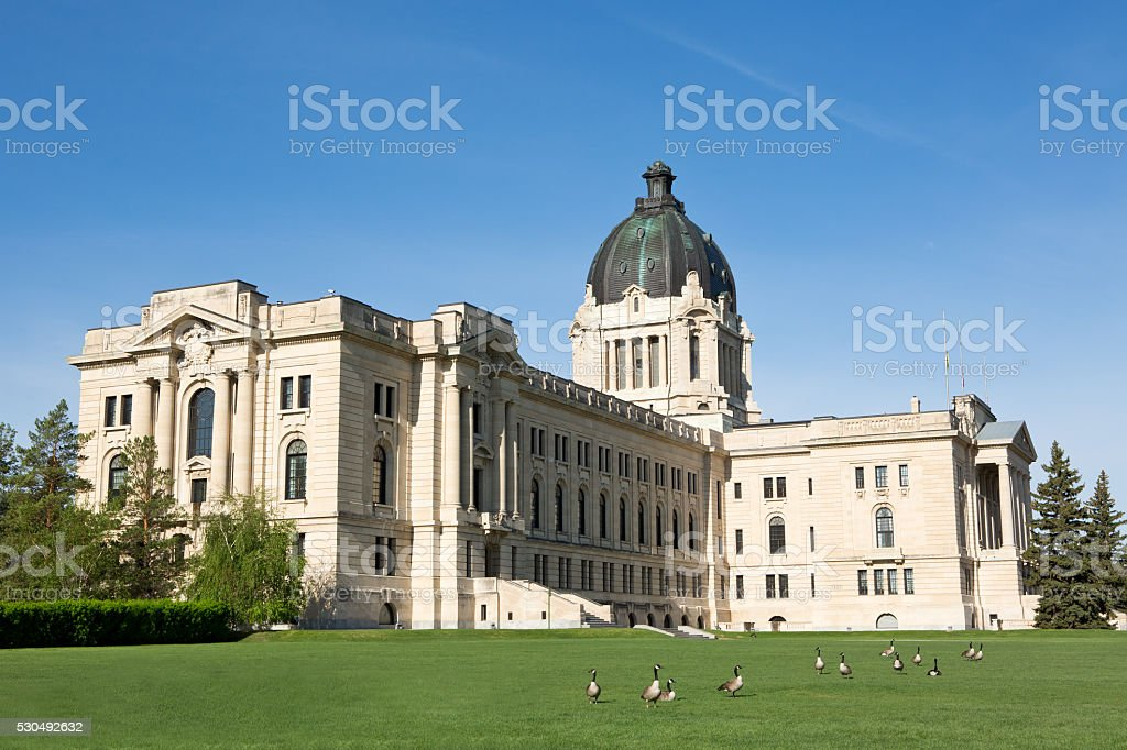 Saskatchewan Legislative Building and Canada geese in Regina stock photo