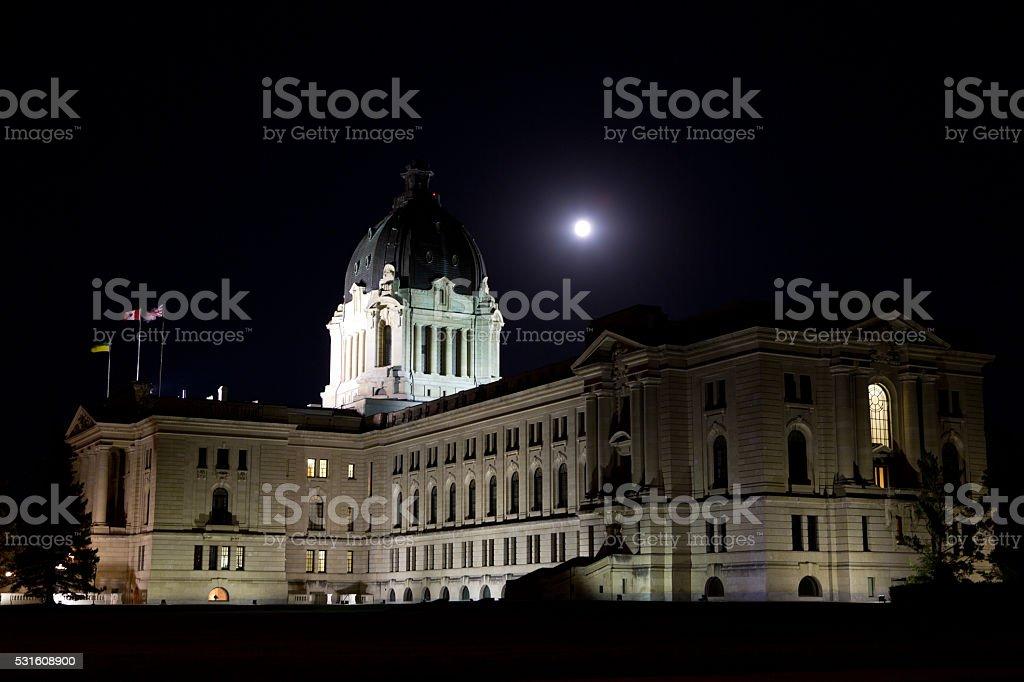 Saskatchewan Legislative Building at night with full moon stock photo
