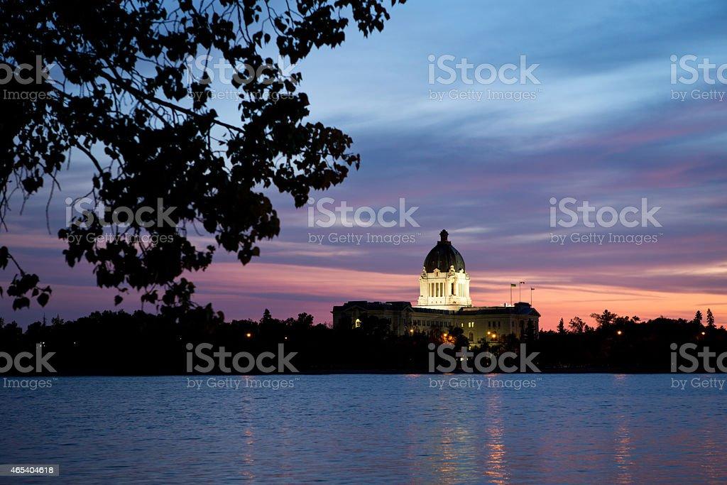 Saskatchewan Legislative Building in Regina at sunset over Wascana Lake stock photo