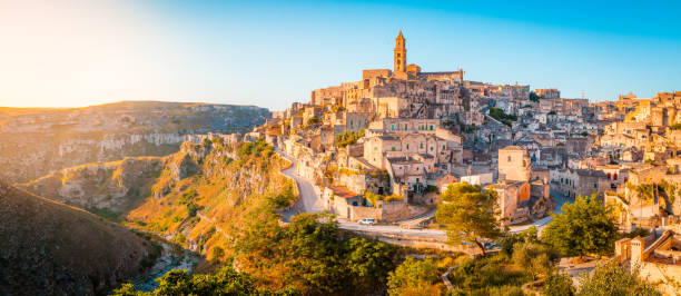 Sassi di Matera at sunrise, Basilicata, Italy Panoramic view of the ancient town of Matera (Sassi di Matera) in beautiful golden morning light at sunrise, Basilicata, southern Italy matera italy stock pictures, royalty-free photos & images
