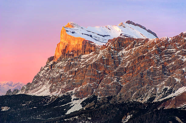 Sasso della Croce (Sass dla Crusc), Dolomites The last rays of the sun on the mountaintop (Sasso della Croce - Sass dla Crusc, Dolomites, italian Alps). high seat stock pictures, royalty-free photos & images