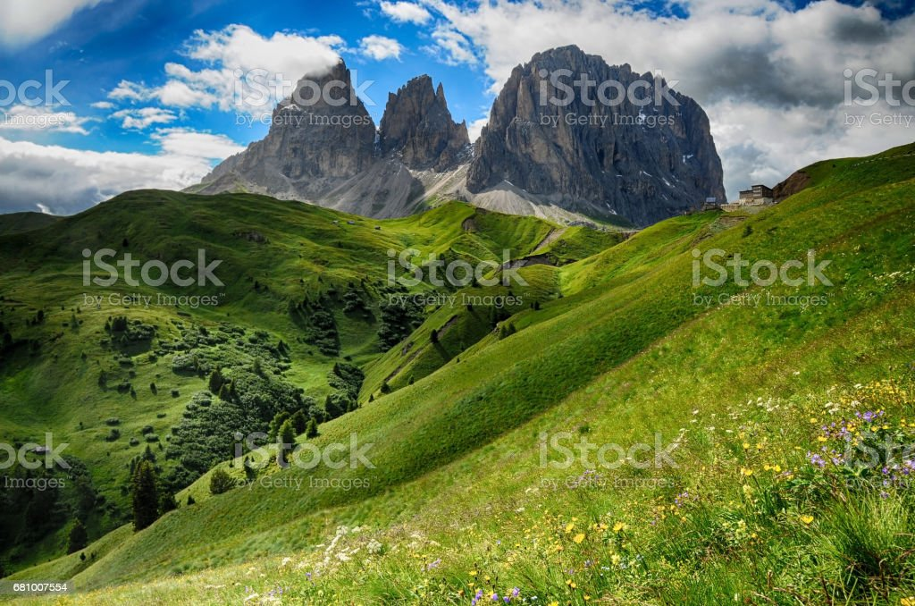 Sassolungo (Lang Kofel) & Sassopiatto Group Mountains, as seen from Passo Sella on a cloudy afternoon, Dolomites, Trentino, Alto Adige, Italy stock photo