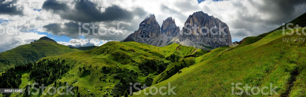 Sassolungo & Sassopiatto Mountain Group as seen from Passo Sella on a cloudy afternoon, Dolomites, Trentino, Alto Adige, Italy stock photo
