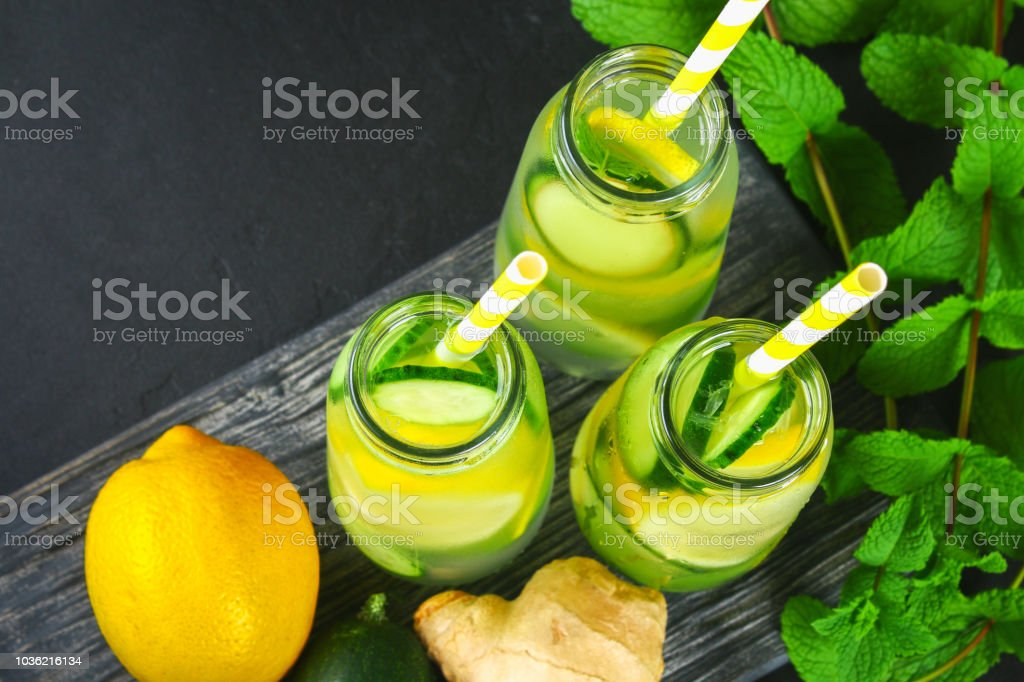 Sassy water. Fresh cool water with cucumber, lemon, ginger and mint. Detox and weight loss. stock photo