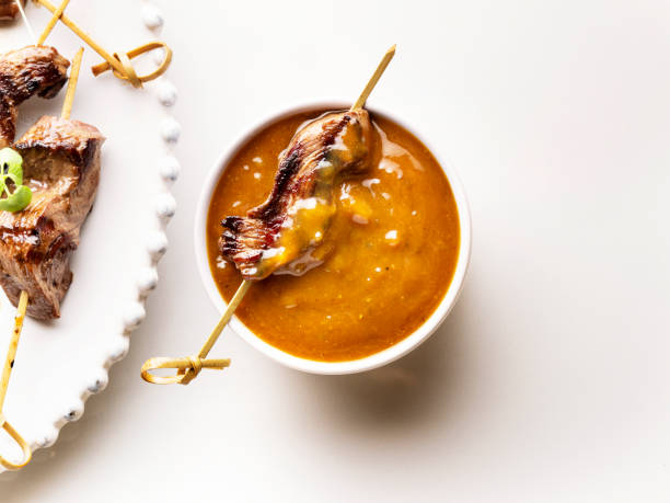 satay sauce with grilled steak,Peanut Sauce,Satay skewered and grilled meat,Beef Satay stock photo