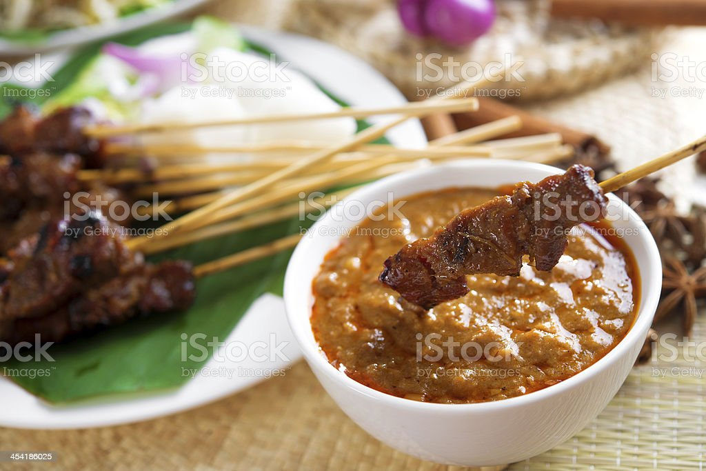 Satay skewered and grilled meat stock photo