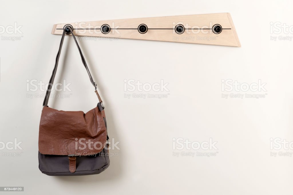 Satchel Hanging on a Wooden Wall Coat Rack stock photo