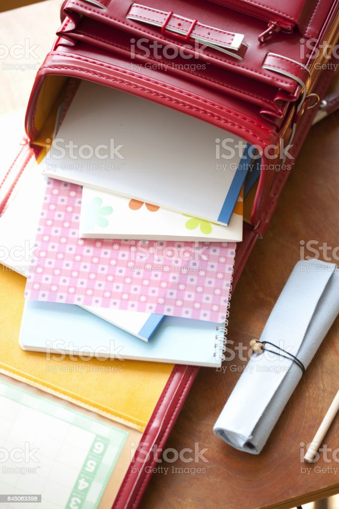Satchel on the table and cherry blossoms stock photo