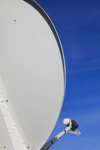 satelite dish on blue sky - pejft stock photos and pictures