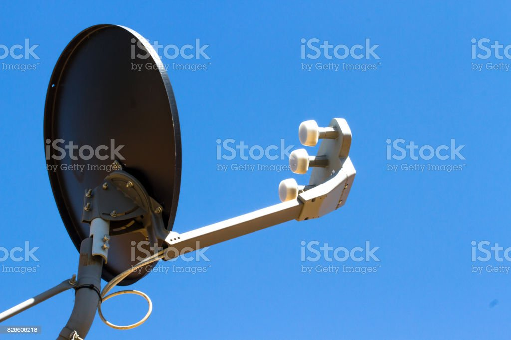 Satellite antenna on house roof stock photo